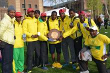 Team and coaches with shield and medals